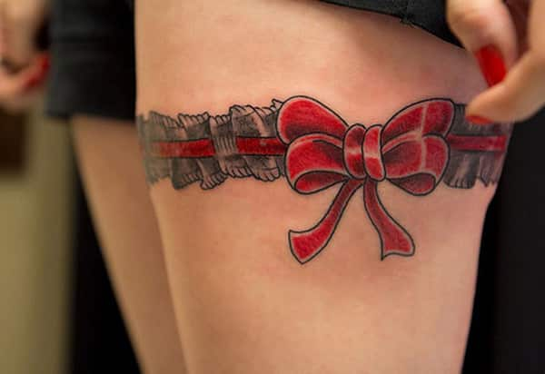 Ribbon-Tattoo-on-thigh