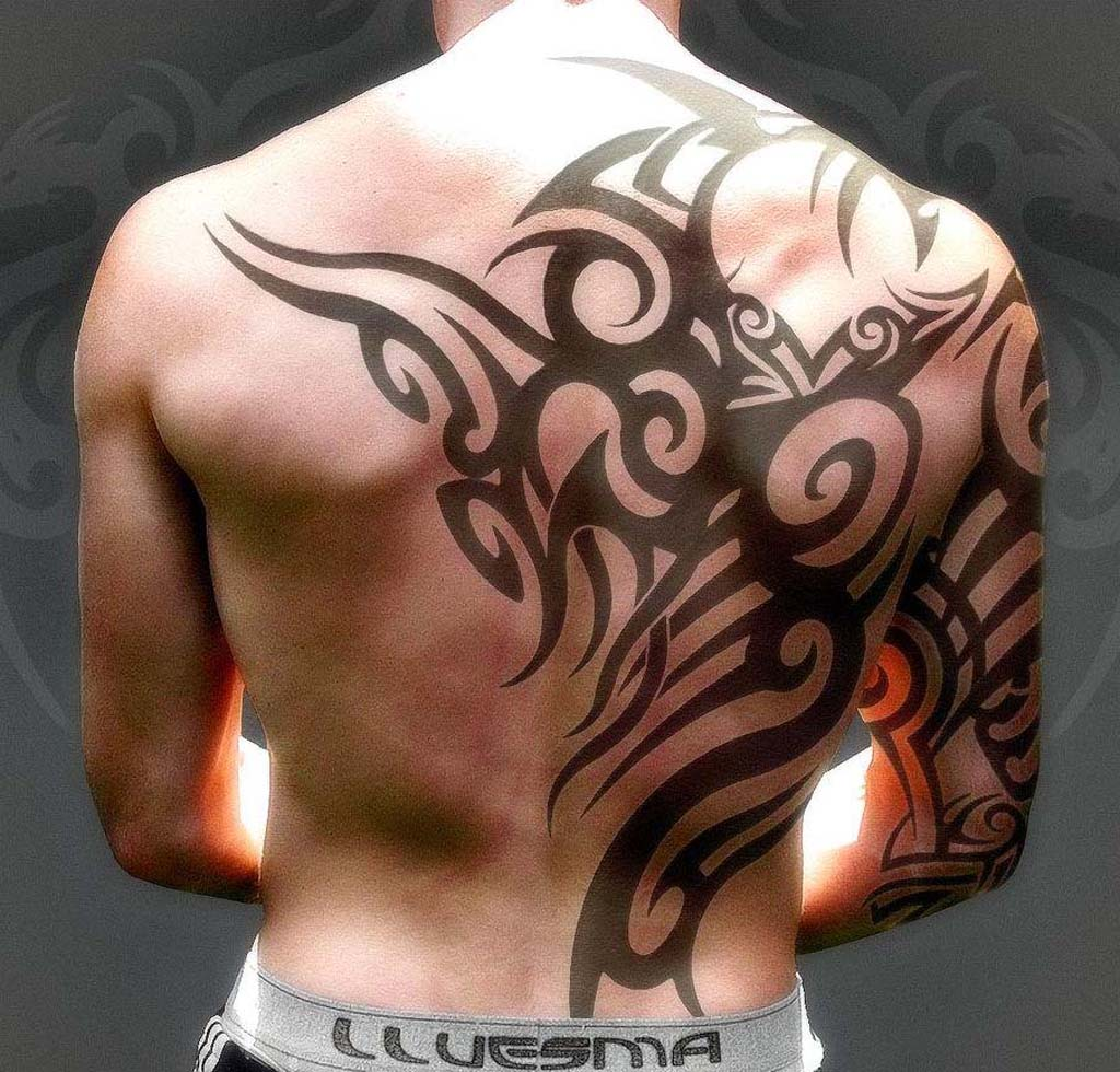 tribal-tattoo-on-back-and-right-sleeve