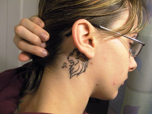 49586bfdd00e3 beneath the earlobe leo tattoos leo tattoos - Tattoo Bytes