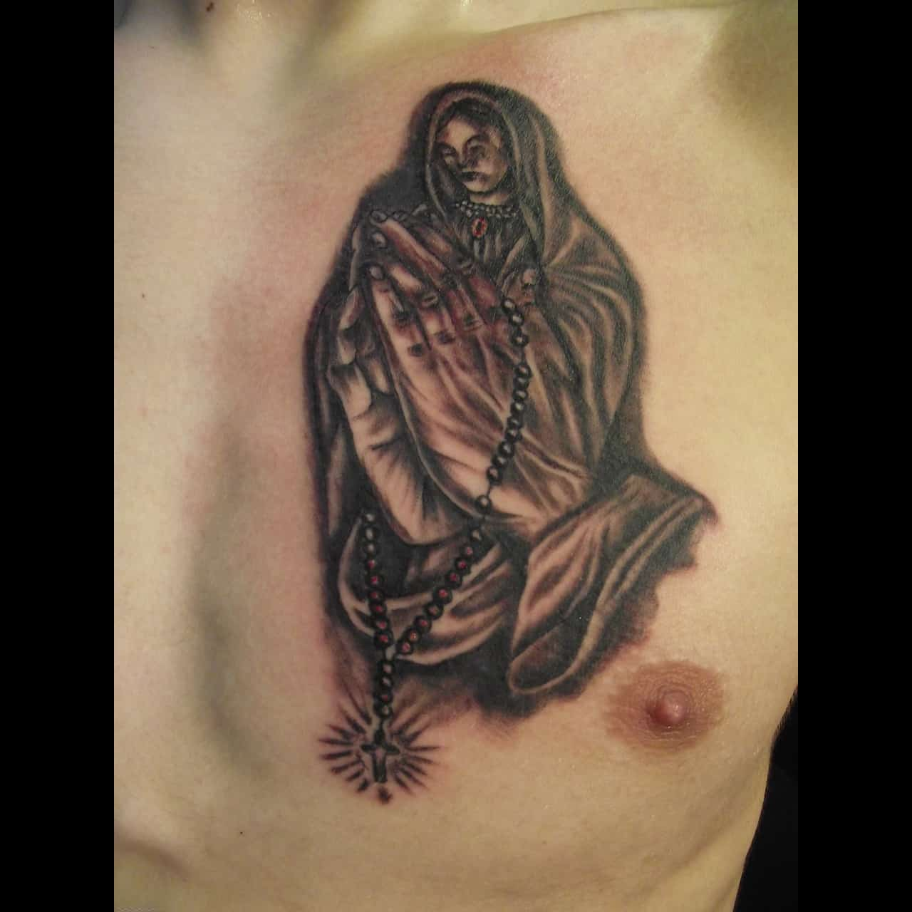 prayer hands mother mary tattoo