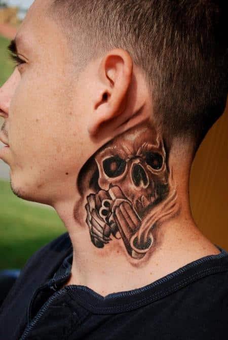 skull-with-gun-tattoo-on-neck
