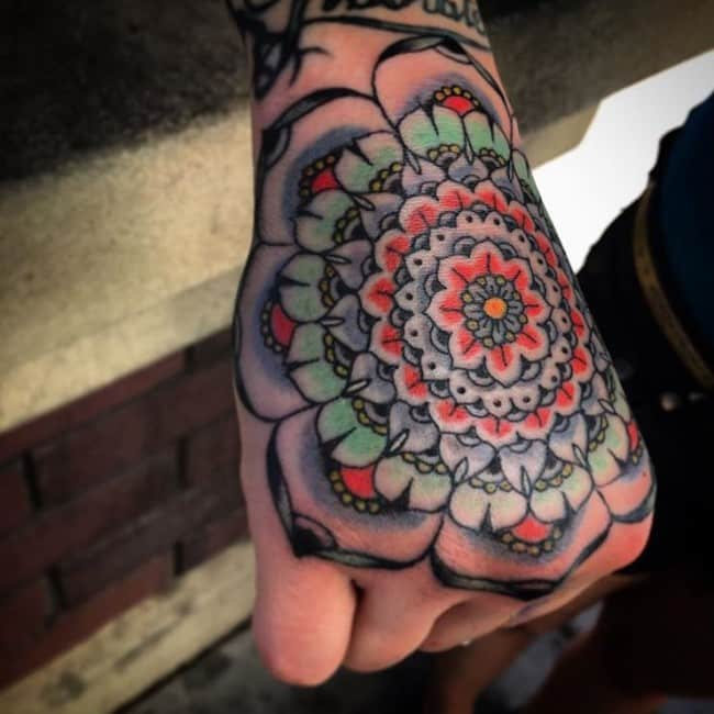 mandalas tattoo on hand