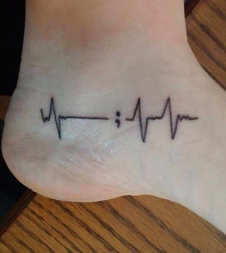 semicolon tatattoo heart beat on foot