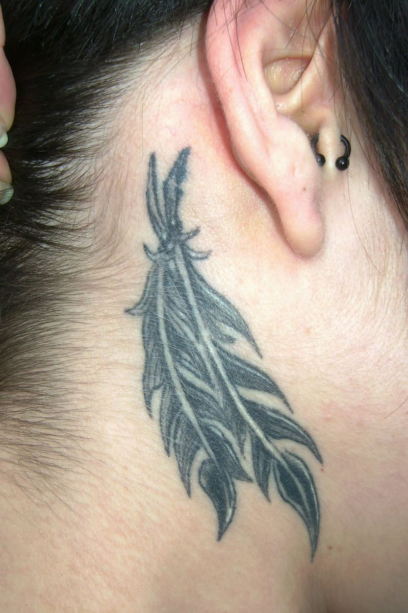 Small Feather Tattoo Behind The Ear