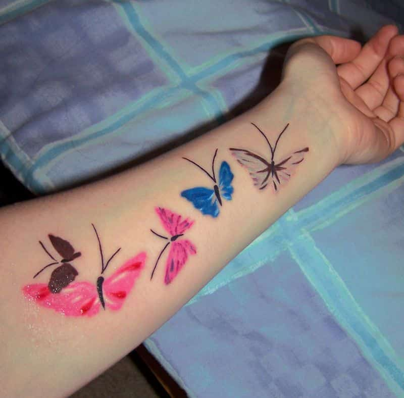 Colored Butterfly Tattoos On Left Forearm