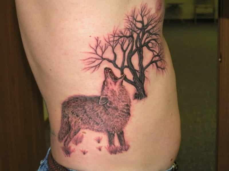 Rib Tattoo For Men Wolf - Tattoo Bytes