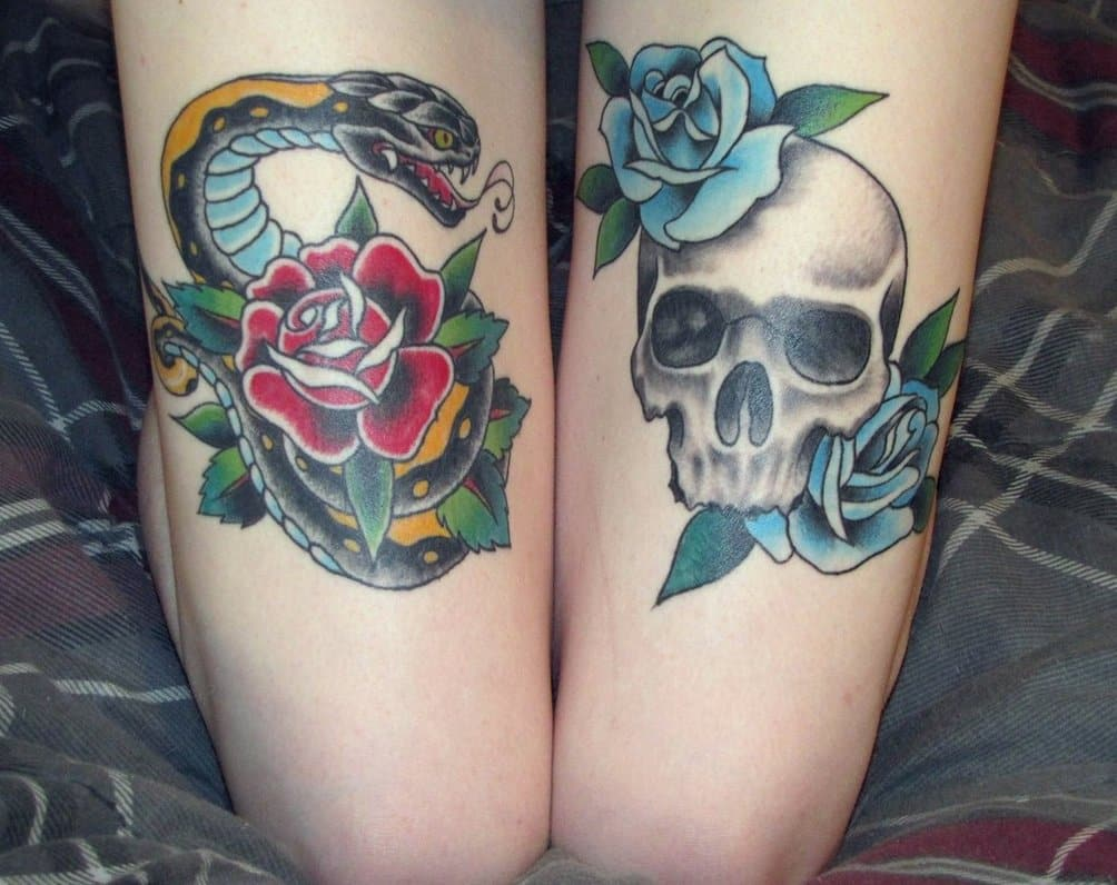 skull and snake thigh_tattoo