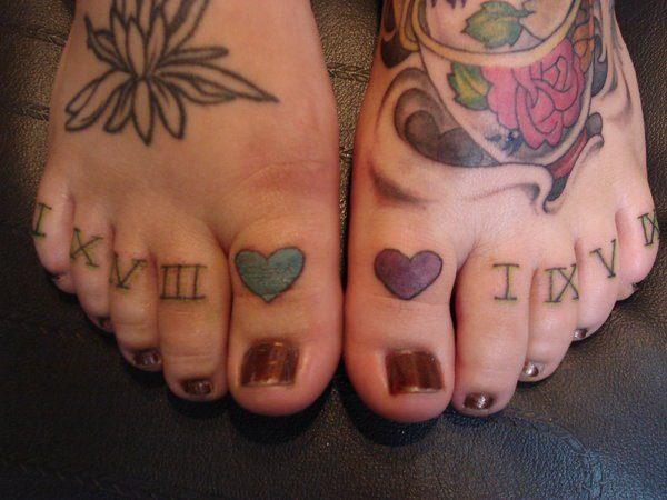 roman-numerals-tattoo-on-feet-for-women
