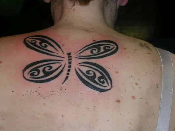 Tribal-Dragonfly-Tattoo-On-Upper-Back