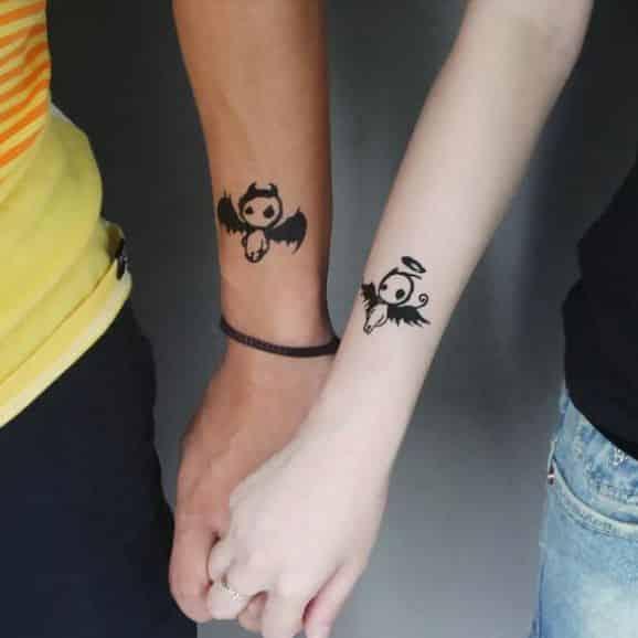 angel-devil-couple-arm-tattoos