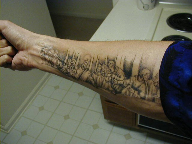 christian tattoo forearm