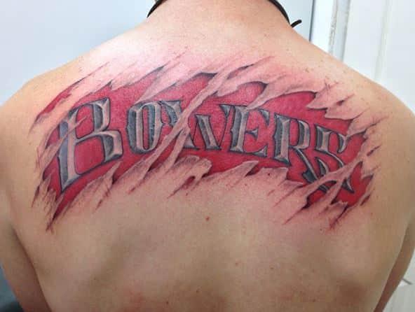 badass-skin-tear-last-name-tattoo