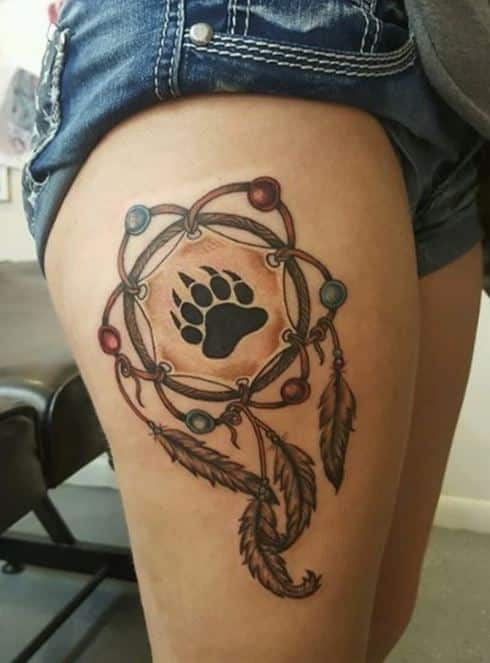 bear-paw-dreamcatcher-tattoos-on-thighs