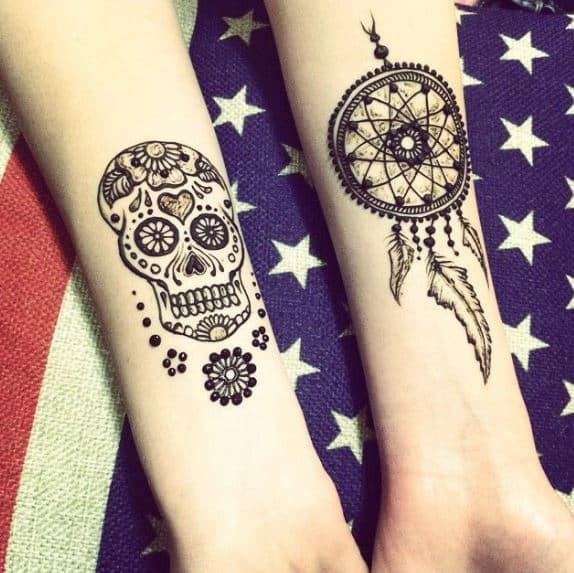 dream catcher tattoos on arms