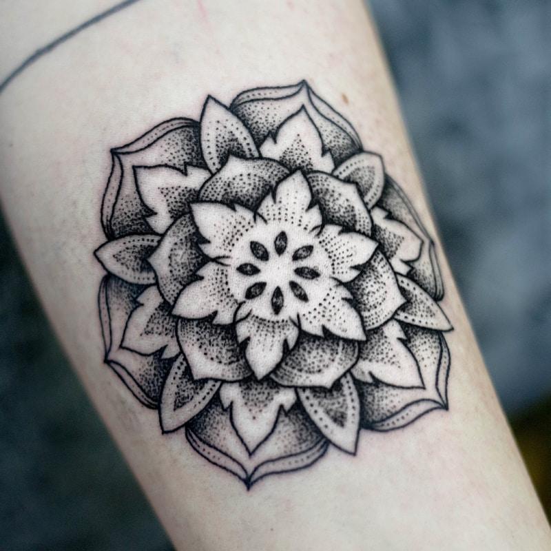 dotwork mandala design tattoo