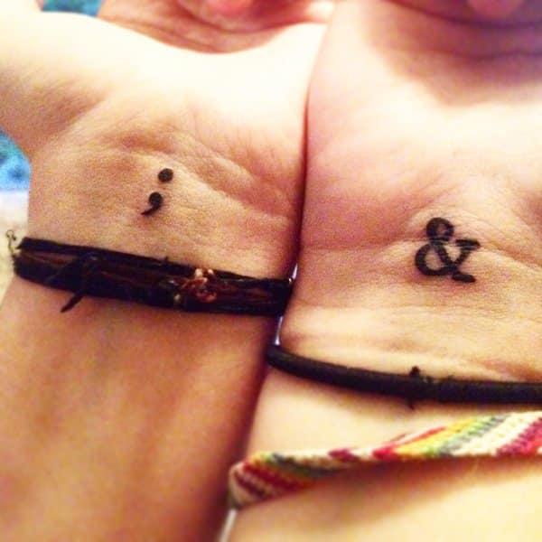 semicolon tattoo on both wrists