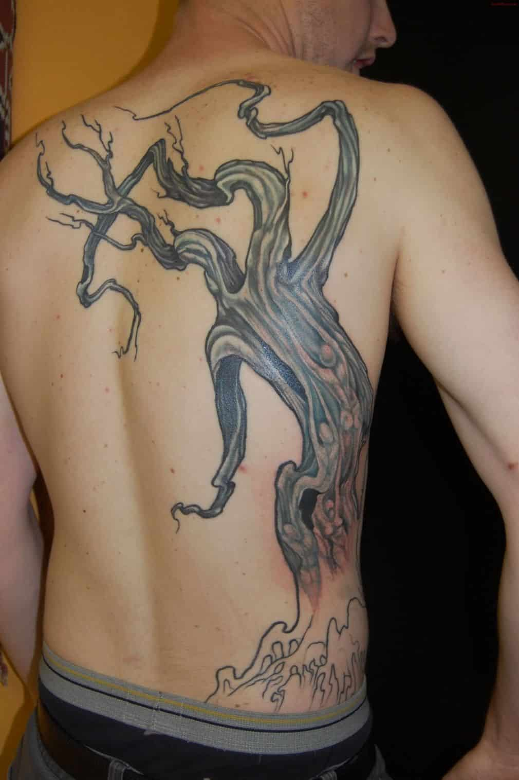 Black Ink Hippie Tree Without Leaves Tattoo On Man Upper Back