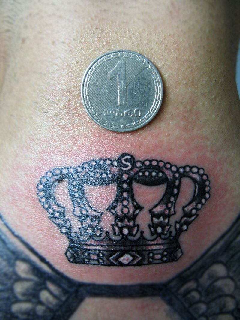 back neck crown tattoo