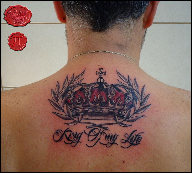 cross with king crown tattoo on shoulder