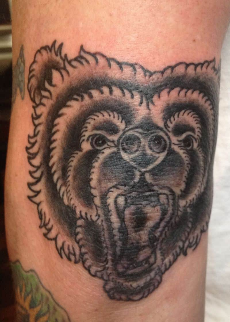 dark ink bear head elbow tattoo