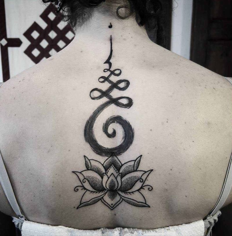 outstanding design and lotus spine tattoo by francesco blackbindu