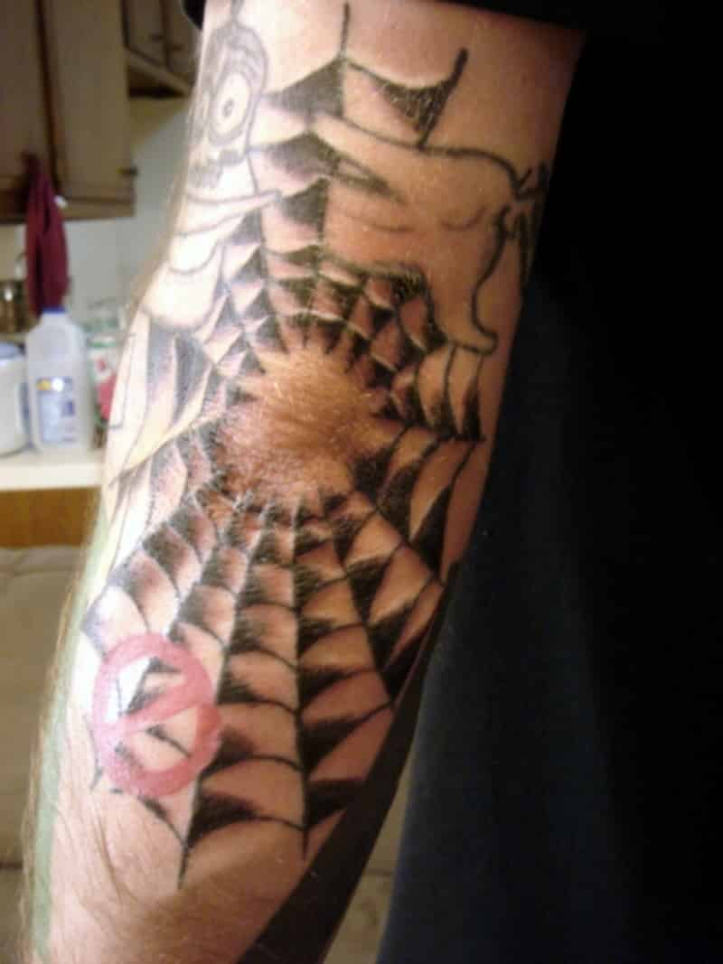 tribal elbow tattoos