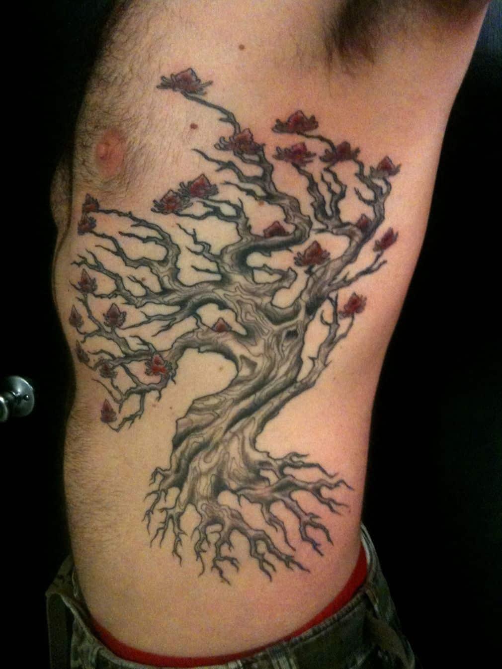 Unique Man Left Rib Side Tree Tattoo