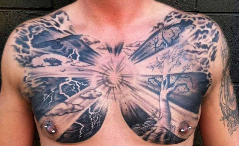Black Ink Clouds With Tree Tattoo On Man Chest