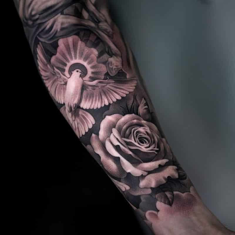 Grey Rose And Flying Dove Tattoo On Left Forearm