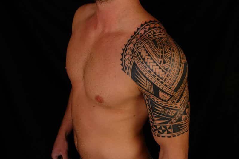 Half Tribal Sleeve Tattoos