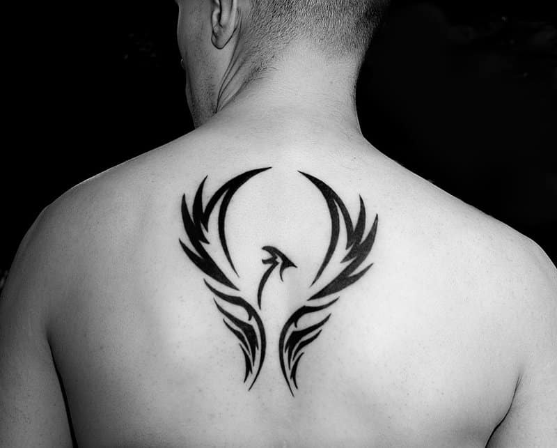 Interesting Idea For A Phoenix Tattoo