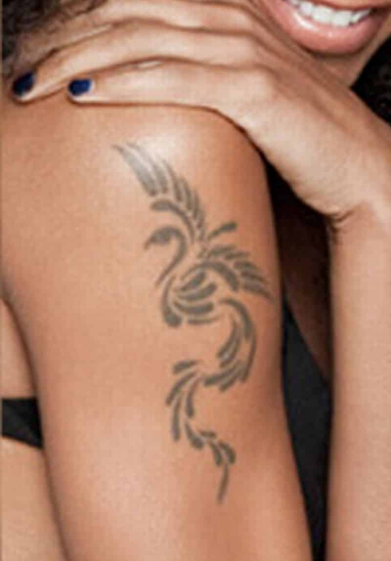 Phoenix Tattoo On Girl Bicep