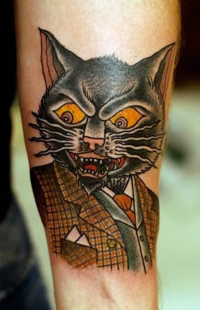 Coloured Angry Cat In A Suit Forearm Tattoo