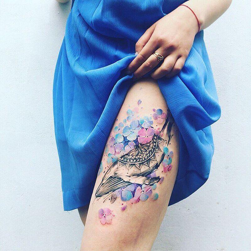 Delicate Watercolor Tattoo