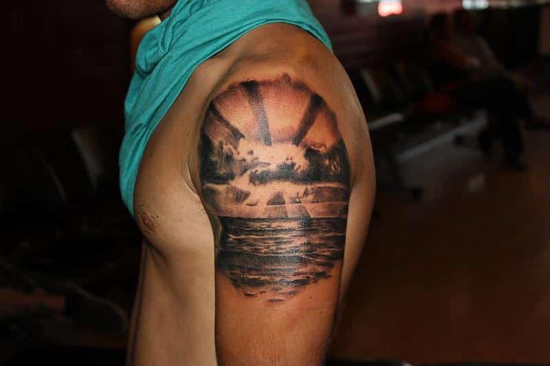 sunset tattoo on arm